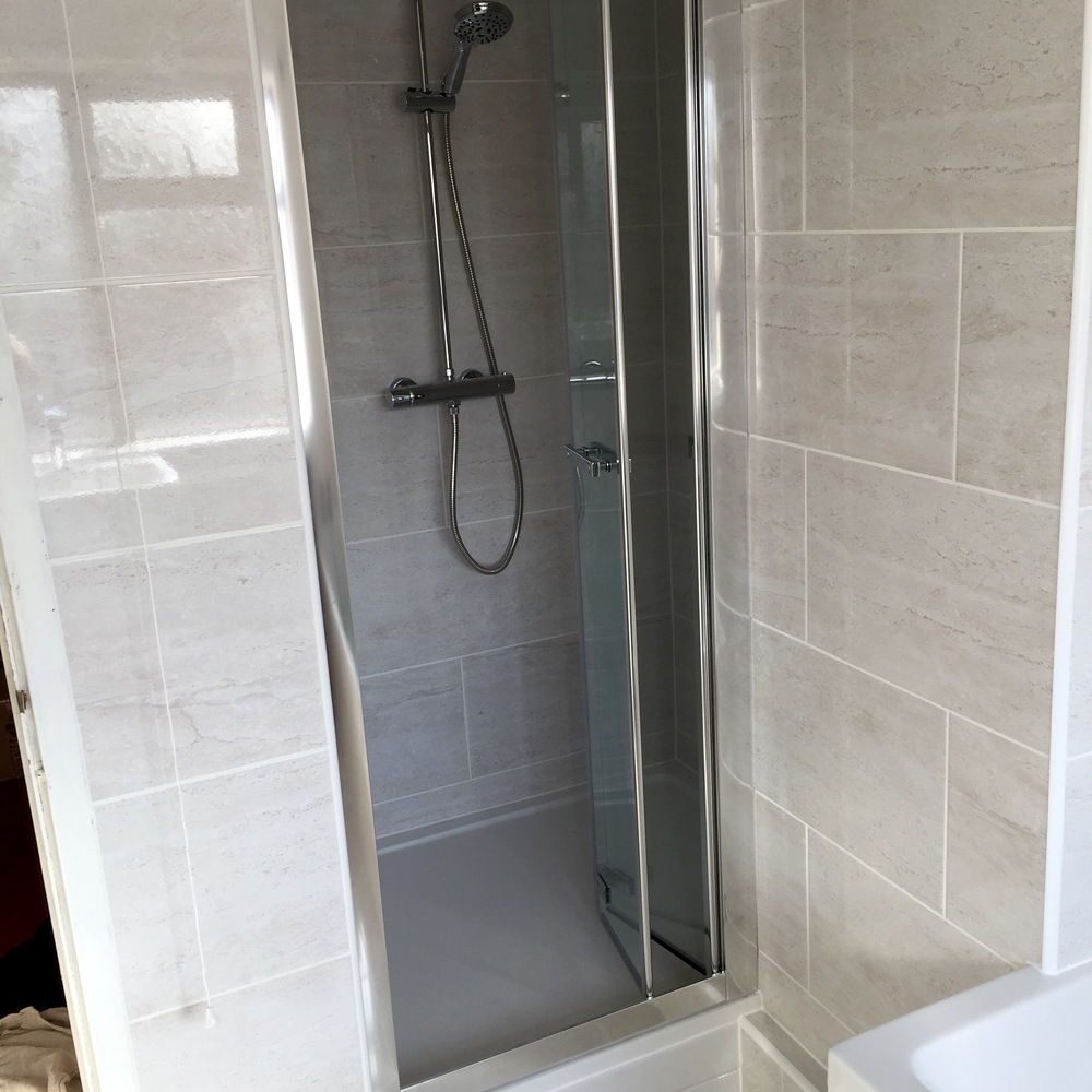 Roman Embrace bi-fold shower door with Adora fusion shower
