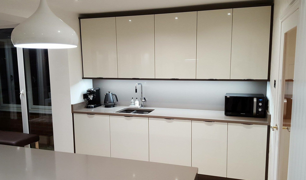 Extra Tall Wall Units Above Sink To Give The Maximum Storage Space