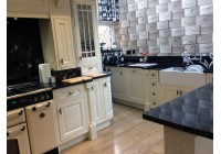 Asor Alabaster Inframe with Cosmic Black Granite Worktops