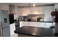 Connoisseur Glacier White Gloss with Black Sparkle Worktops