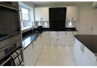 Signature Porter White Gloss and Black Quartz Worktops